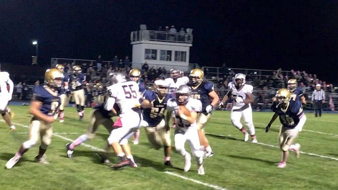 New Egypt's Ty Wharton (9), Nick Surdo (54), Ashton Sempervive (76) and Jakob Kramer (19) pursue Holy Cross running back Matt Paolini during last season's West Jersey Football League meeting. All four New Egypt players are returning this season.
