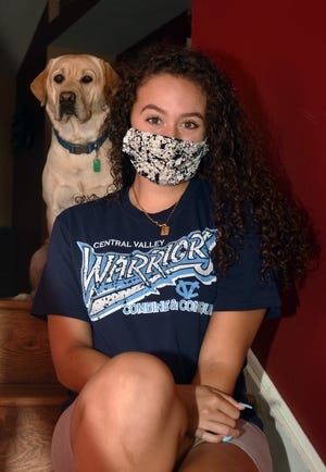 Central Valley High School senior Breannan Colville at home with her dog, Cheech.