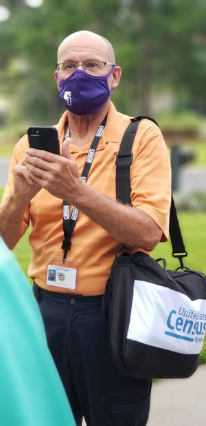 Don Kassel, a census worker in the Hardeeville area, collects information during a recent stop.
