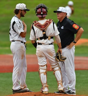 Braxton Davis and Austin Curry talk with Coach Pugh during a Post 45 game on July 17, 2019.[Photo by Paul Church/The Courier-Tribune]