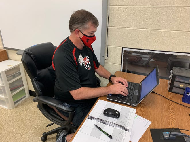 Chad Hench works in his classroom at Central Davidson High School. [Contributed photo]