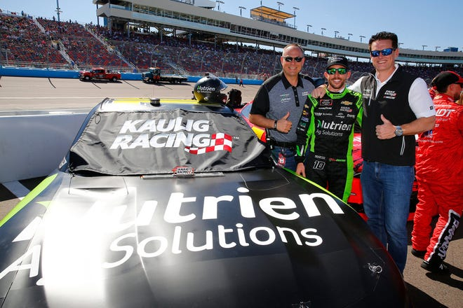 Driver Ross Chastain stands between team owner Matt Kaulig (right) and Chris Rice (left), president of Kaulig Racing while at Kentucky Motor Speedway on July 10. [Russ DeSantis Photography]