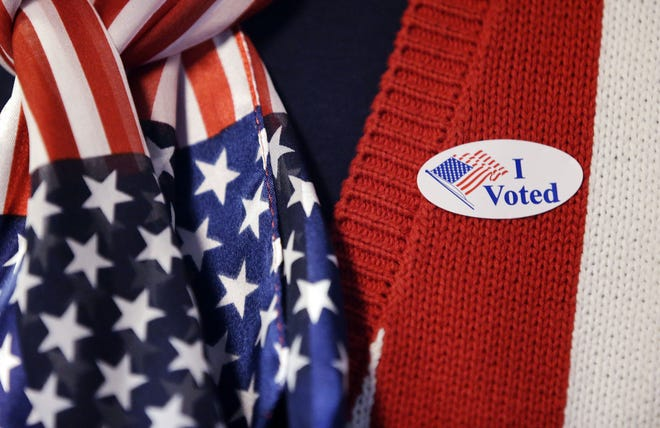 """A voter wears a """"I voted"""" sticker after voting in the Indiana Primary at the Hamilton Co. Auto Auction, Tuesday, May 3, 2016, in Noblesville, Ind. (AP Photo/Darron Cummings)"""