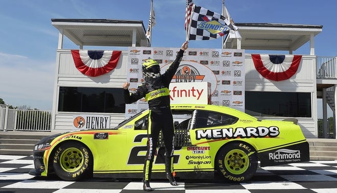 Austin Cindric celebrates his most recent NASCAR Xfinity Series victory at Road America in Elkhart Lake, Wisconsin.