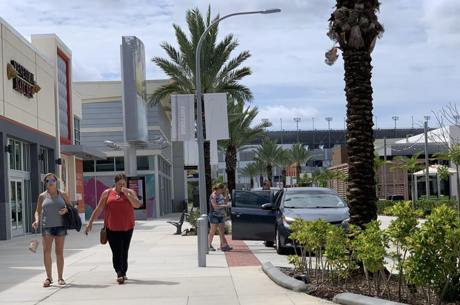 Pedestrian traffic was sparse at One Daytona on some summer days, like this one in late July. The entertainment/retail complex across the street from Daytona International Speedway, visible in the distance, was expected to create thousands of jobs and become a year-round destination for shopping, dining and entertainment.