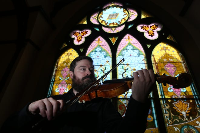 Violinist Jeffrey Phillips is shown May 11, 2017, at First United Methodist Church in Burlington. Phillips, executive director of the Southeast Iowa Symphony Orchestra, co-founded the Burlington Lunchtime Chamber Music Series along with Roger Hatteberg, highly respected local musician and music educator.