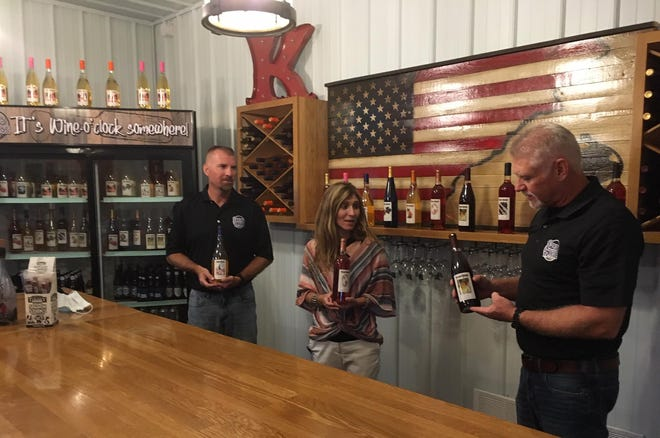 Press House Winery owners are shown, from left, Darren Koechle, Denise Koechle and Bryan Koechle,  in Nauvoo, Illinois. [Bob Hansen The Hawk Eye]