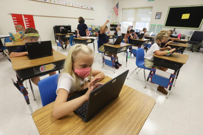 Annemarie Baxter, 7, works on an ABC program in her second-grade class at Notre Dame Elementary School Tuesday, Aug. 11, in Burlington.