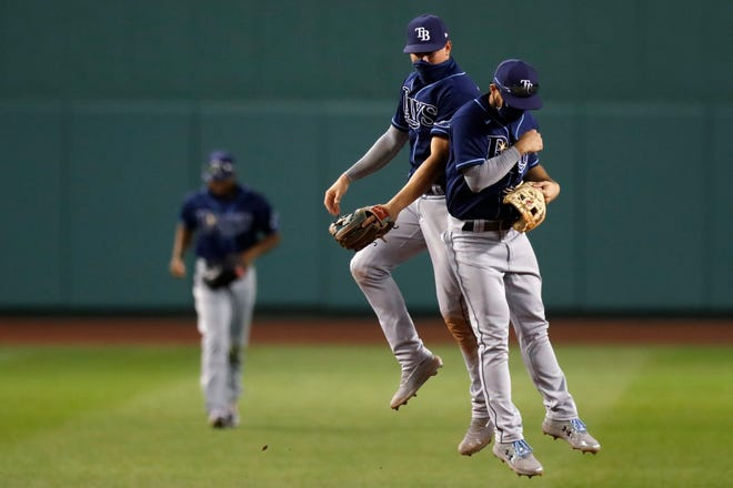 Tampa Bay Rays Brandon Lowe, right, and Willy Adames celebrate after beating the Boston Red Sox  Thursday in Boston. [MICHAEL DWYER/THE ASSOCIATED PRESS]