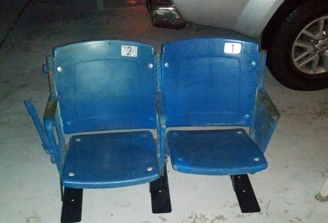 These two 55-year-old seats were rescued from the Tiger Stadium demolition in 2007. Retrieved recently from a warehouse in Mount Dora, they have found a new home and are already making at least one fan happy again. [BILL KEMP/THE LEDGER]