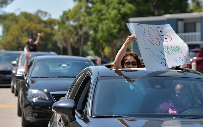 Teachers and staff from Rogers Garden-Bullock Elementary in Manatee County staged a parade in March to show support for their students after in-person schooling was shut down when the coronavirus outbreak began. Manatee students return to school Monday.