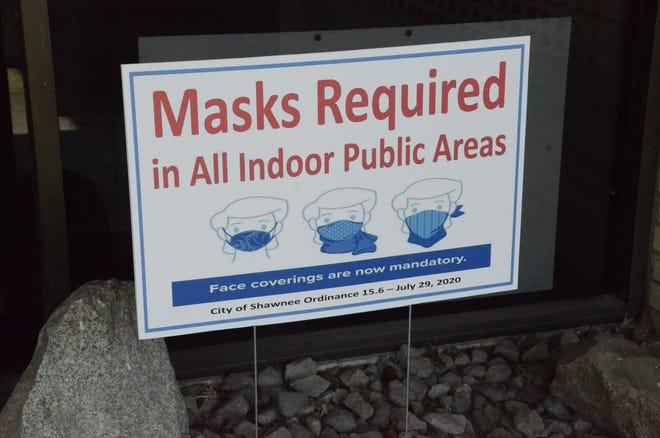 A sign just outside of City Hall in Shawnee, Okla., reminds residents of a mask ordinance in effect there.