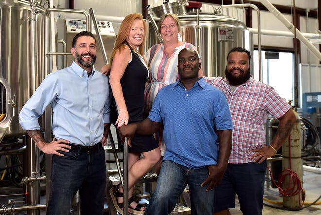 Dirtbag Ales Brewery & Taproom Co-Owner Jackie Hall and Operations Manager Shannon Loper, Co-Owners Eric Whealton Jerry Hall and Toto Simmons-Valenzuela. [Ed Clemente/For The Fayetteville Observer]