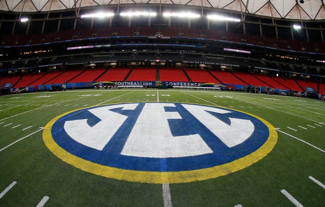 SEC logo is displayed on the field ahead of the Southeastern Conference championship football game between Alabama and Missouri in Atlanta. (AP Photo/John Bazemore, File)