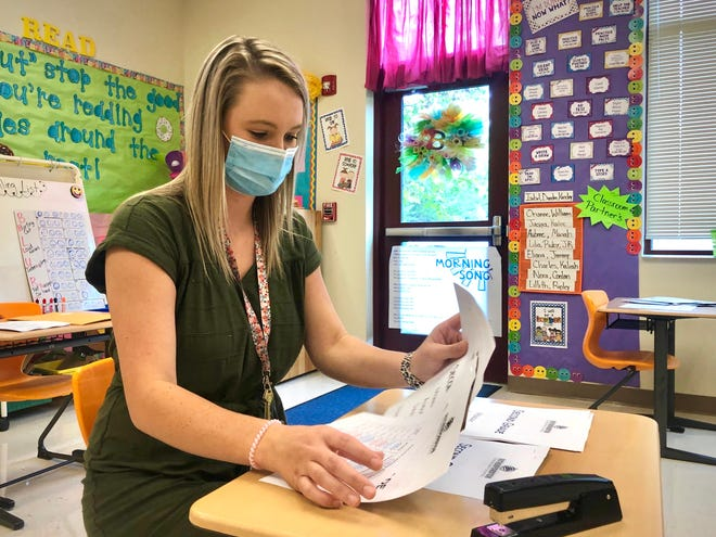 Second-grade teacher Bailey Hardin prepares paperwork for the upcoming school year on Friday, Aug. 14, 2020, at Rutherfordton Elementary School in Rutherford County, North Carolina. Some North Carolina teachers (but not Hardin) have publicly expressed concern about catching COVID-19 if they have teach in their school buildings instead of from home while teaching online classes.