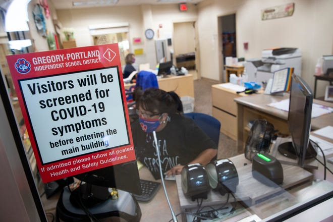 Signs for COVID-19 screenings welcome people at the entrance of S.F. Austin Elementary in Gregory as the school prepares for in-person teaching set to start on September 8, 2020.