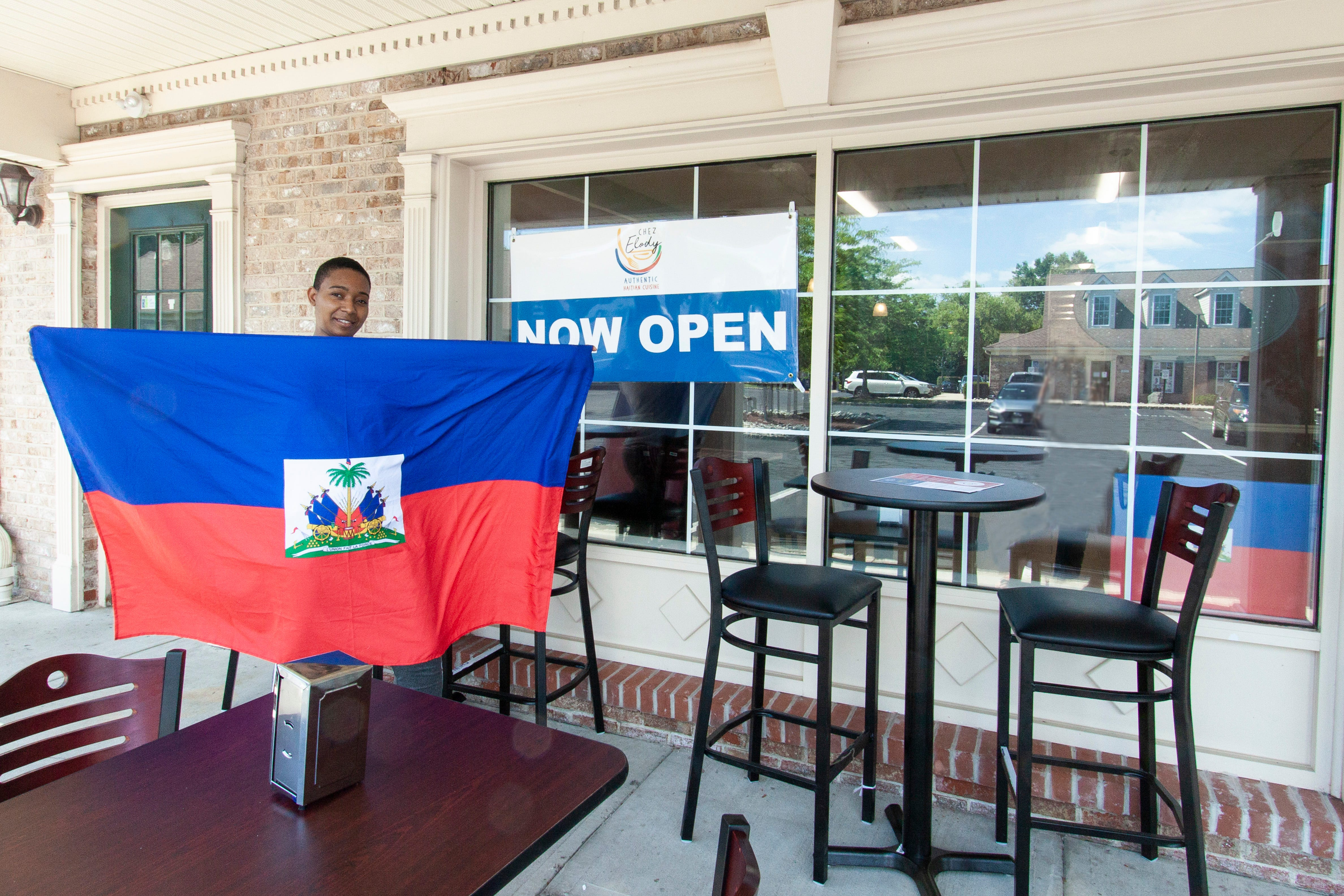A new Haitian restaurant Chez Elody has opened at 378 South Branch Road in Hillsborough. Co-owner Diane Henry is pictured with te Haitian flag.