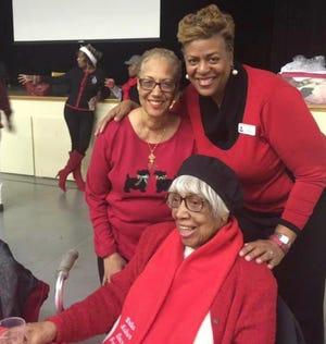 Frances Webb (sitting), Carole Watson (left) and Kim Trent (right).