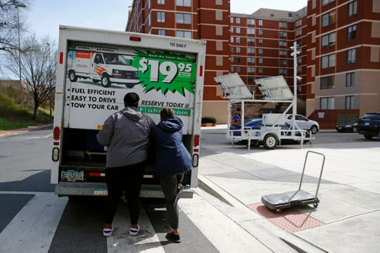 Students finish loading belongings into a U-Haul truck as they move out of their dorm in Washington.  Moving is stressful enough without throwing a pandemic into the mix.  If you are considering moving, be prepared for things to work a little differently and plan ahead to make it less of a hassle.