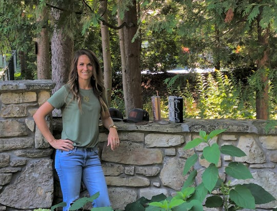 Made in Door County Owner Kylie Beenken poses with items for sale on the new website alongside goods from several area businesses.