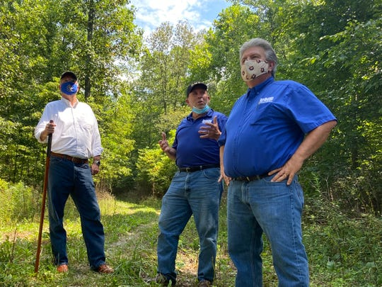 Gov. Eric Holcomb (left) stands with the DNR Forestry Division Director John Seifert (middle), and DNR Director Dan Bortner after a ribbon cutting on Aug. 14 at Ravinia State Forest. The forest is one of two that were established during the ceremony.