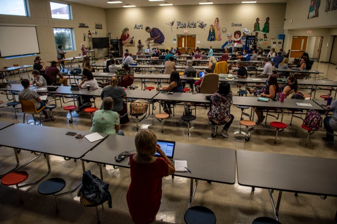 Teachers at Rosehill School have a meeting to discuss the new school year policy in Jackson, Tenn., Tuesday, Aug. 11, 2020.