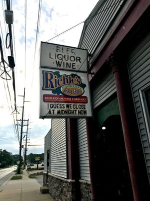 """The owners of Riehle's Neighborhood Bar & Grill, 1301 Union St. in Lafayette, changed their sign Friday, Aug. 14, 2020, swapping the bar's regular 3 a.m. closing time most nights for, """"I guess we close at midnight now."""" The sign coincided with the start of a Tippecanoe County health officer order that limits bar and restaurant hours to help curb the spread of coronavirus. Starting Friday, bars and restaurants must clear out by midnight."""
