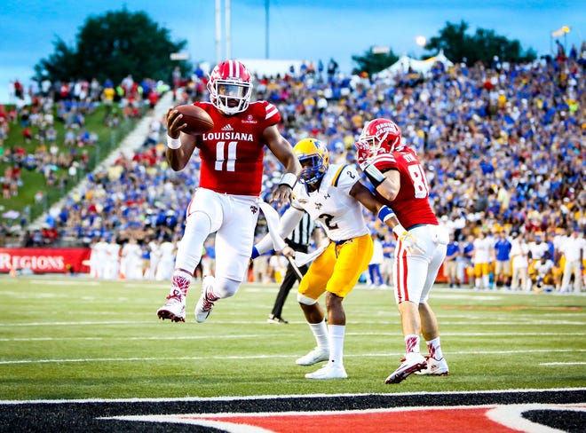 Then-UL quarterback Anthony Jennings jumps into the end zone during a 2016 win over McNeese at Cajun Field. This year's Ragin' Cajuns-Cowboys game has been canceled.