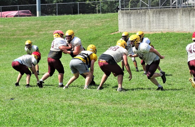 The Berne Union football team runs drills during a recent practice. The Rockets are hoping they will get to play their season, which opens Aug. 28 against rival Fisher Catholic.