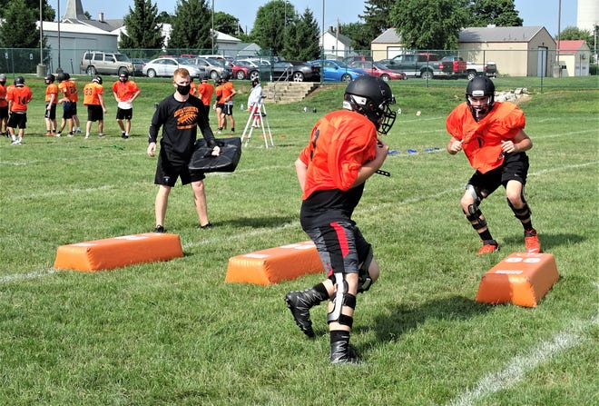 Amanda-Clearcreek players run through drills during a recent practice as they prepare for the upcoming season.