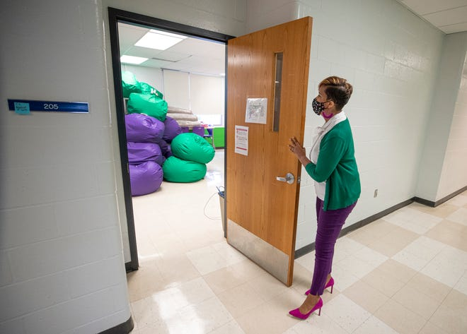 Ronda Cosby, principal of the Grace James Academy opens the door to one of the rooms at the new Afrocentric girls school in Louisville on Friday.