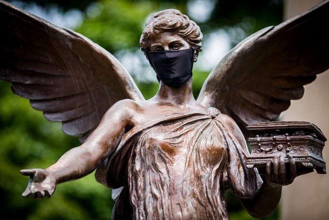 "A mask is placed on Ball State's ""Beneficence"" statue Friday, Aug. 14, 2020."