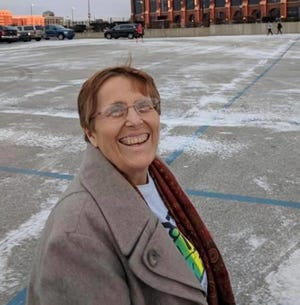 Denise Moore in a photo taken by family at a marathon race in downtown Indianapolis.