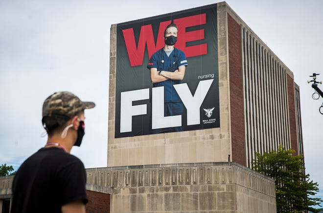Ball State's new banner hanging on the university's Teacher's College building features a masked nurse Friday, Aug. 14, 2020.