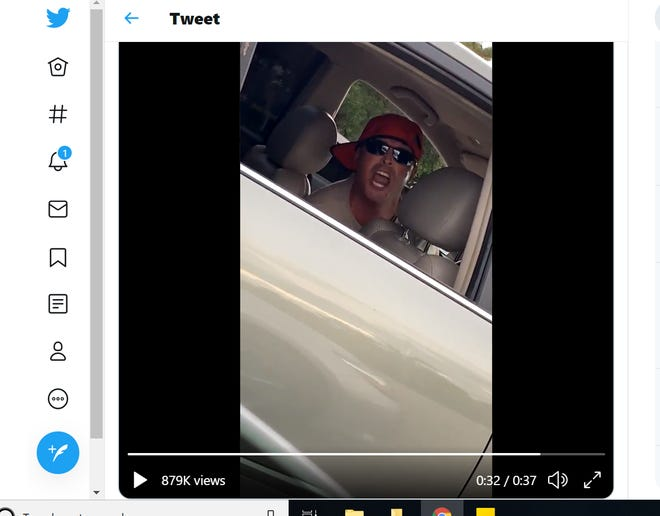 A screenshot of a tweet shows a man in a video that is said to have been shot in Naples. The man in the video threatens a woman and uses a variety of obscene language and racist slurs.