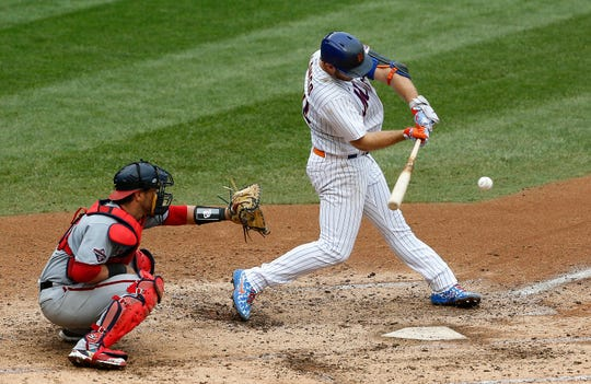 Aug 13, 2020; New York City, New York, USA; New York Mets first baseman Pete Alonso (20) singles against the Washington Nationals during the fifth inning at Citi Field.