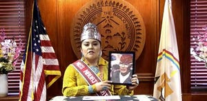 Miss Navajo Nation Shaandiin Parrish holds up a photo of her late grandfather Navajo Code Talker Paul Parrish.