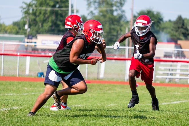 Port Huron's Caleb Collier (25) runs during a drill at practice Friday, Aug. 14, 2020, at Port Huron High School.