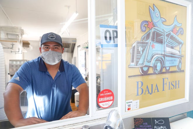 Jorge Salmeron, owner of Baja Fish, poses for a portrait at The Yard Food Park, in Salem, Oregon, on Wednesday, Aug. 12, 2020.