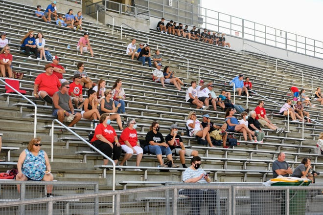 Spectators are scattered in the stands for the Lincoln vs Yankton girls soccer game on Friday, August 14, at Howard Wood Field in Sioux Falls.