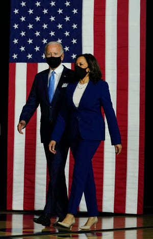 Democratic presidential candidate Joe Biden and his running mate, Sen. Kamala Harris, arrive for a campaign event at A.I. du Pont High School in Greenville, Del., on Aug. 12.