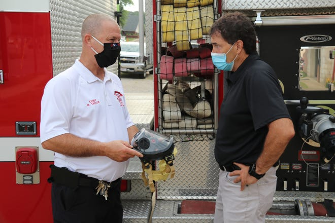 U.S. Representative Troy Balderson, right, talks with South Zanesville Fire Department Chief Russell Taylor about the equipment the department will be able to purchase with the help of a FEMA grant.