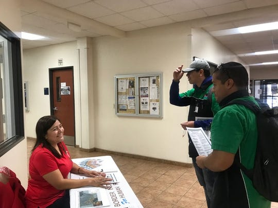 Activist Irma Cruz, left, is shown talking to students at Western Technical College in El Paso, Texas, last fall. Cruz currently is trying to get residents of the Texas city to fill out the 2020 Census. Many experts warn that a severe undercount due to sped up timelines is likely to greatly impact communities of color.
