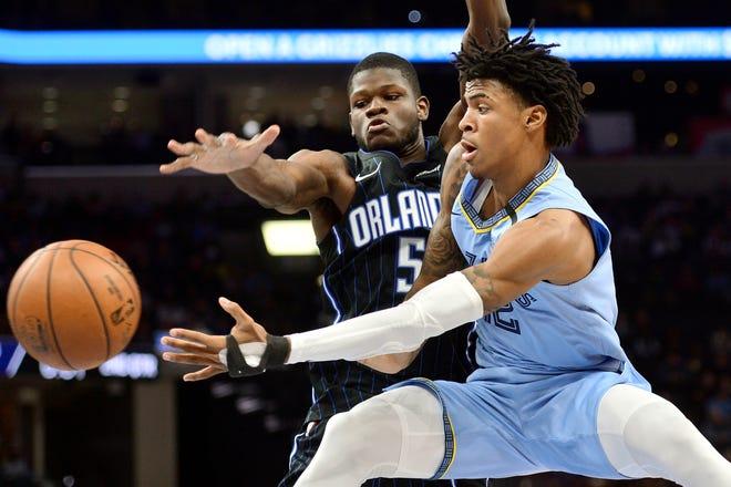 Orlando Magic center Mo Bamba (5) defends Memphis Grizzlies guard Ja Morant during a game in Memphis, Tenn., in March.