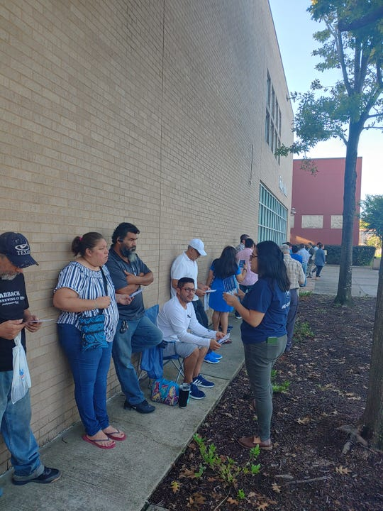 Texas-based civil rights activist Génesis Sanchez, at right, speaks to a group of volunteers before a pre-coronavirus training session. The volunteers are focused specially on encouraging Latinos to fill out the 2020 Census. Texas has one of the nation's highest rates of uncounted households, which if left unchanged could result in a negative impact on federal funding and political representation in those communities.