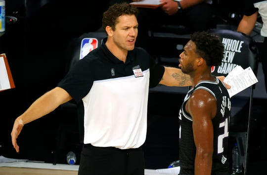 Sacramento Kings coach Luke Walton talks with Buddy Hield during Thursday's game.