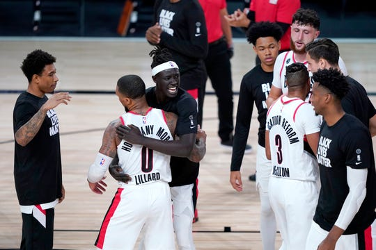 Damian Lillard is congratulated by teammates after the Portland Trail Blazers' win over the Brooklyn Nets.