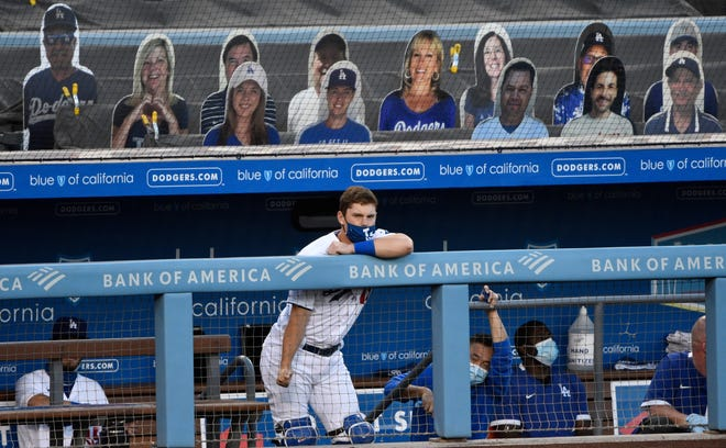Los Angeles Dodgers catcher Will Smith (16) watches the action from the dugout during the third inning against the San Diego Padres at Dodger Stadium on Aug 12, 2020.