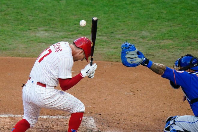 Phillies first baseman Rhys Hoskins is hit by a pitch during Friday's win over the Mets.