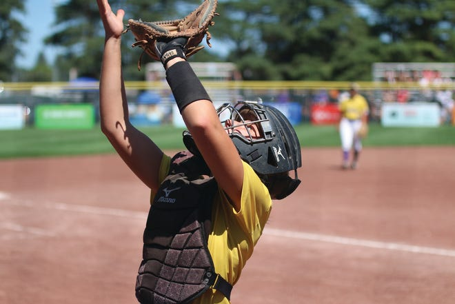 Waukee senior Natalie Wellet getting set to catch a pop fly during the Class 5A state quarterfinal game against Ankeny Centennial